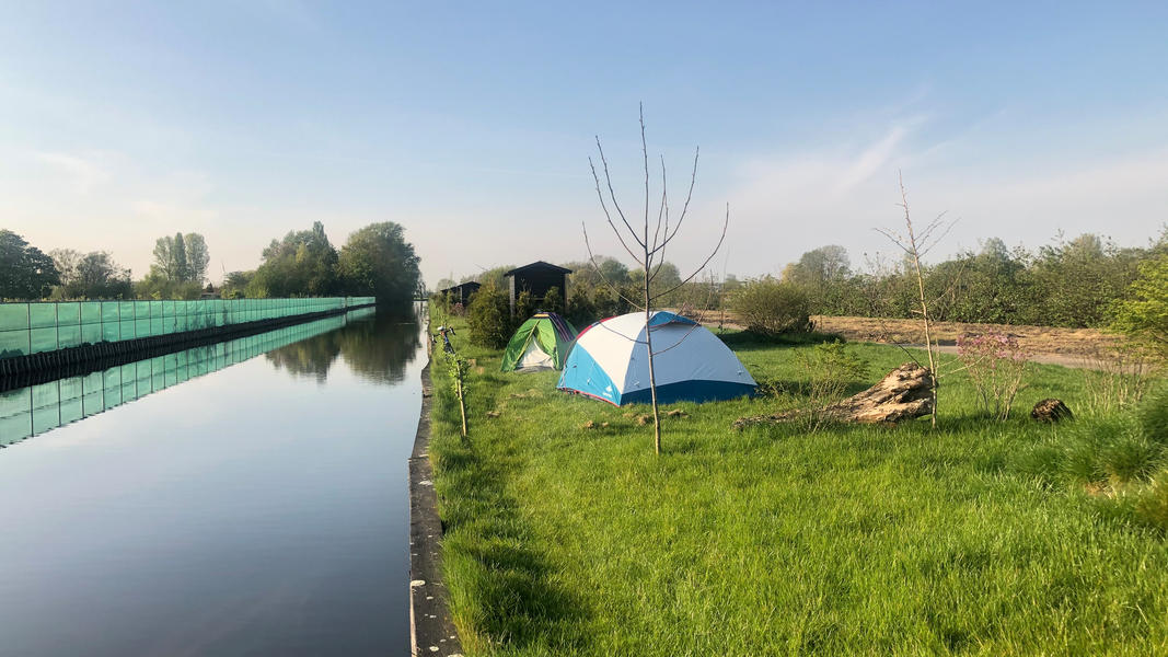 Surround yourself with nature and row a boat at our small scale camping #1