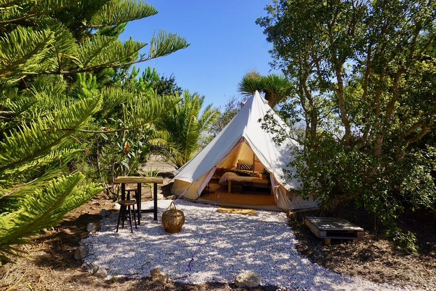 PRIVATE LUXURY BELL TENT SET IN TROPICAL GARDEN